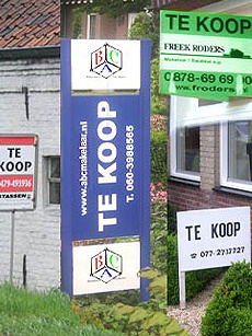 Various home sale signs