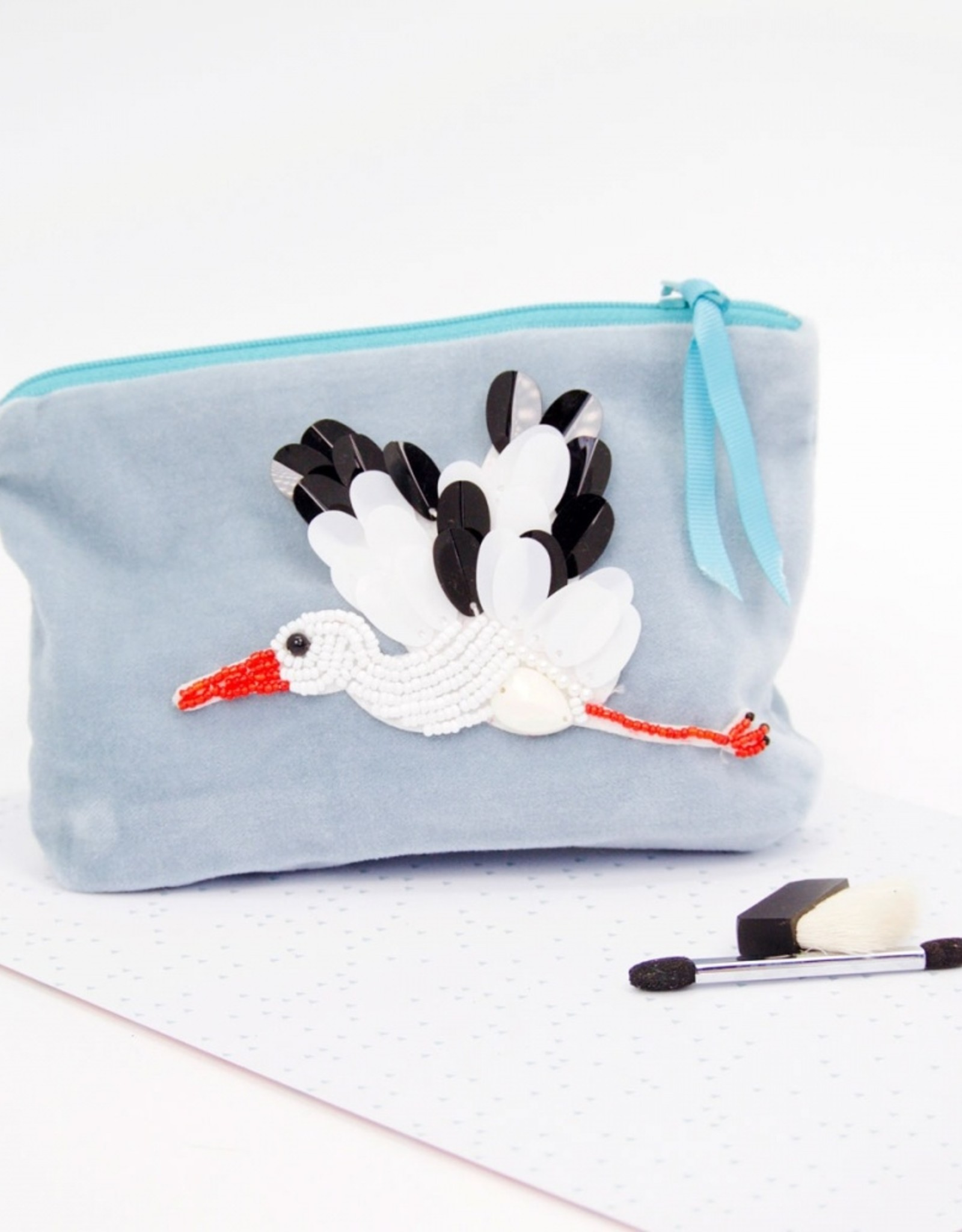 Sequined stork bird velvet pouch