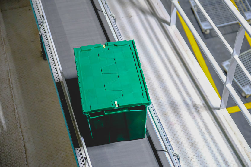 Attached Lid Toto Box on Conveyor Belt