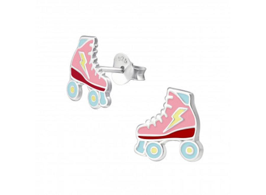 Silver ear studs roller skate