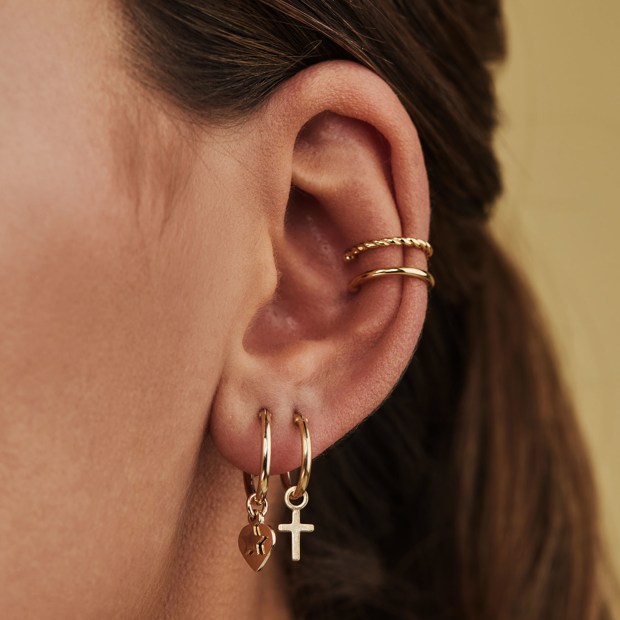 Selected Jewels Julie Esthée 925 sterling silver gold colored creoles with hearts and stars