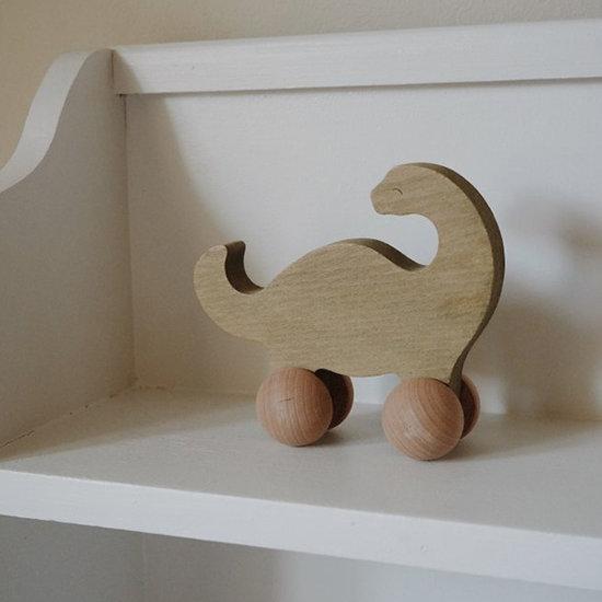 Konges Slojd Konges Slojd Rolling Brachiosaurus - push toy