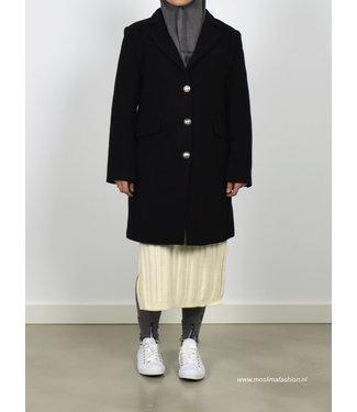 Outfit zwarte mantel