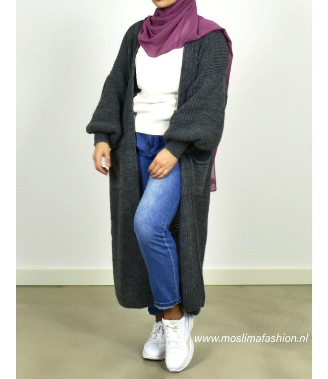 Outfit lang vest en jeans