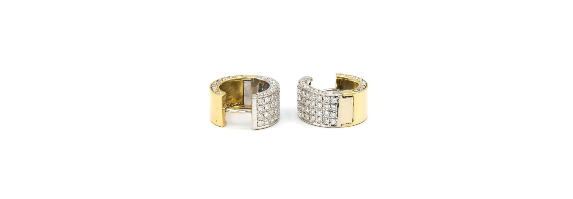 Oorbellen bicolor creolen met in totaal 160 diamantjes