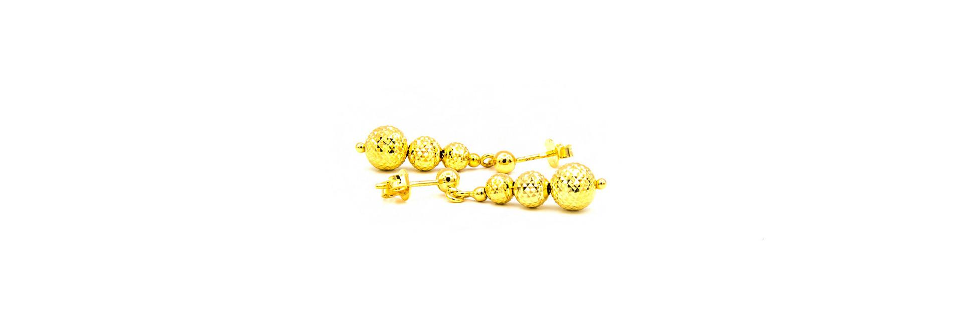 Oorbellen met gediamanteerde ballen