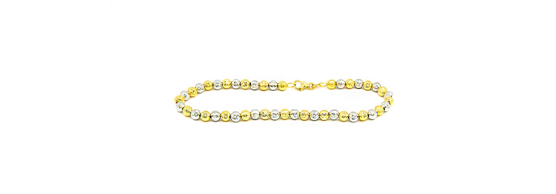 Armband bicolor met gediamanteerde kleine bolletjes