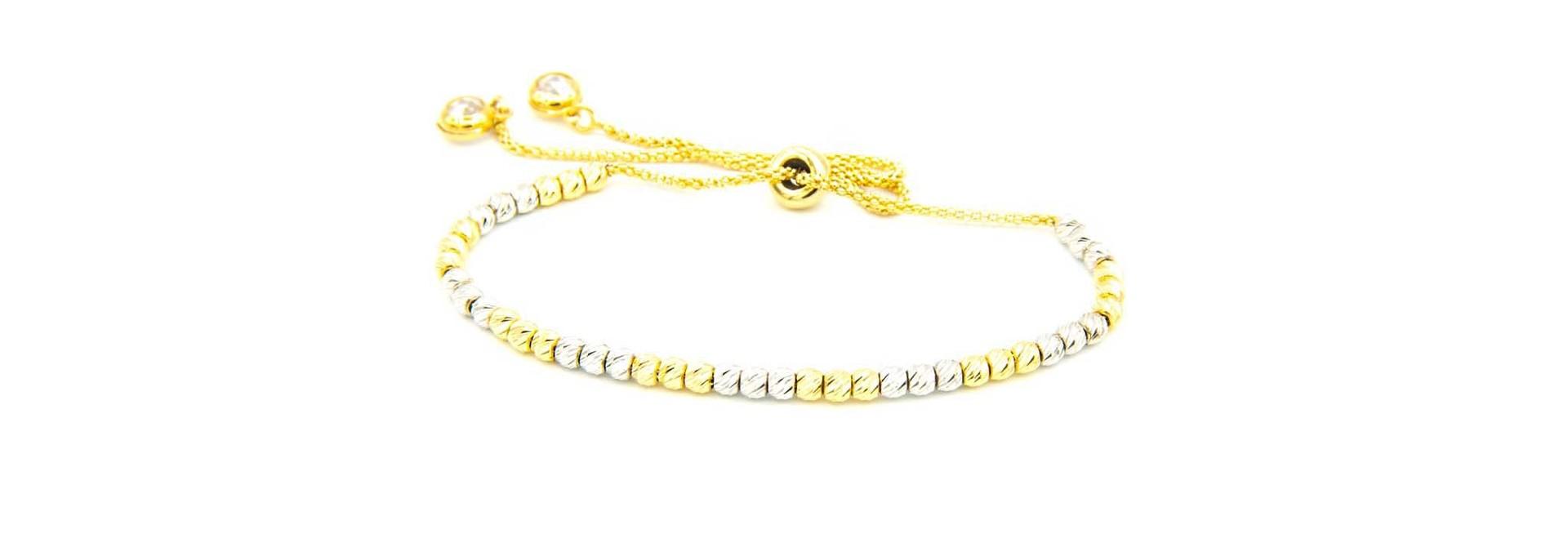 Armband bicolor met diamond cut balletjes en zirkonia's