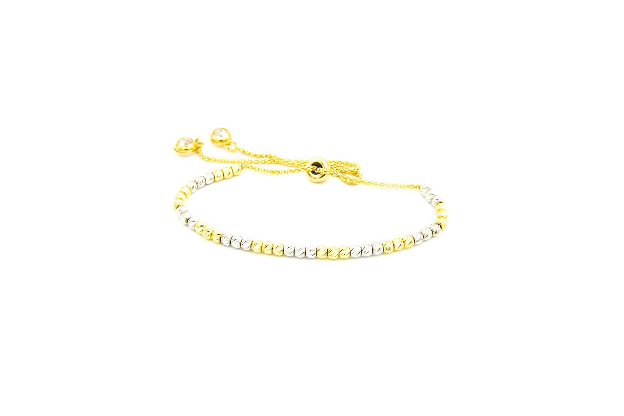 Armband bicolor met diamond cut balletjes en zirkonia's-1