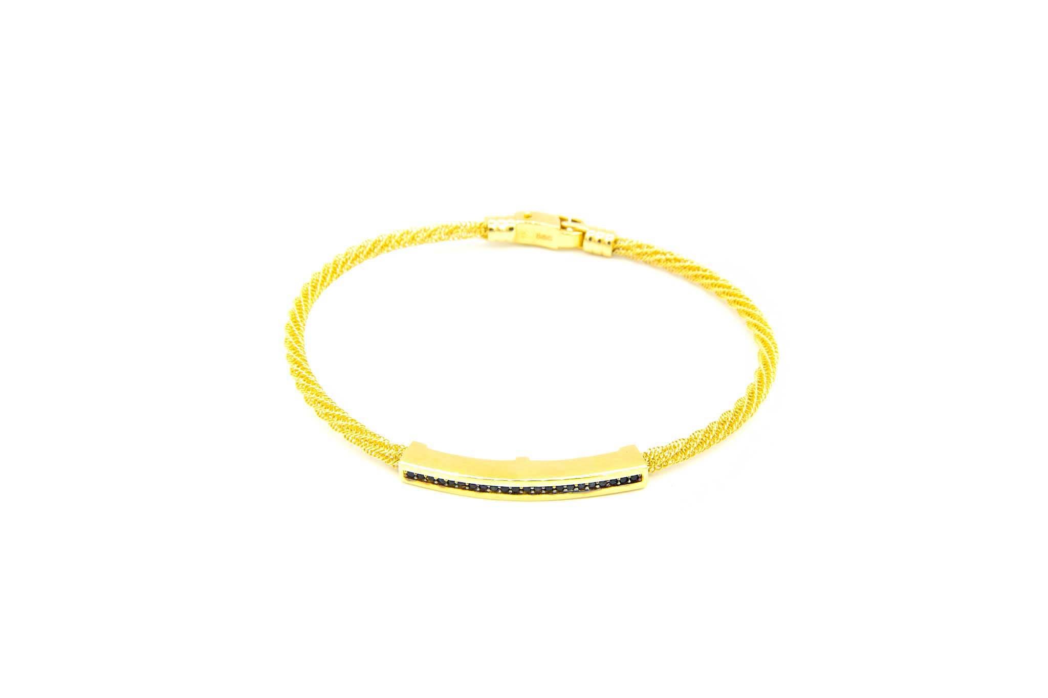 Armband met opengewerkte vaste band en gouden strip ingelegd met zwarte zirkonia's-2