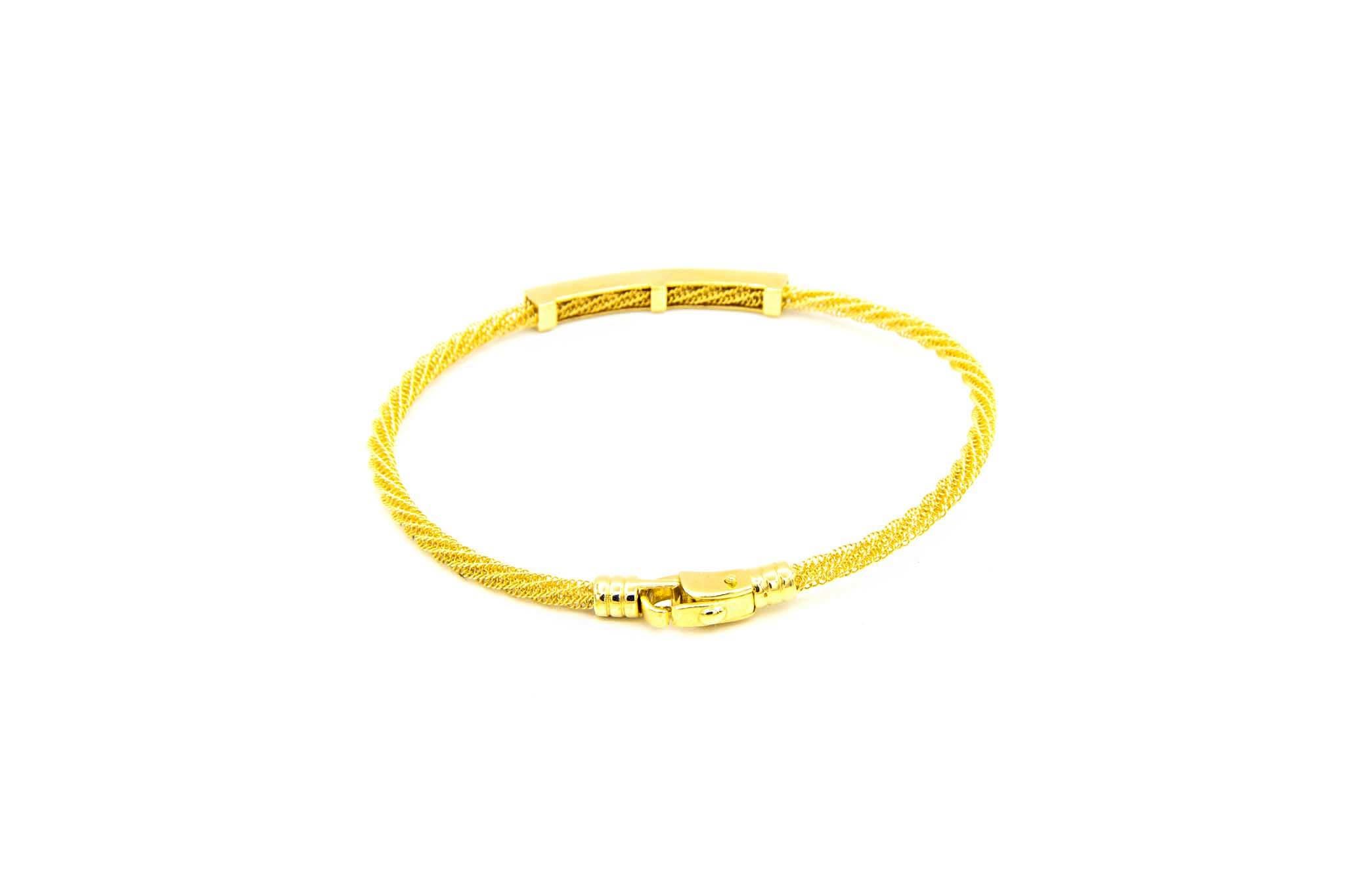 Armband met opengewerkte vaste band en gouden strip ingelegd met zwarte zirkonia's-3