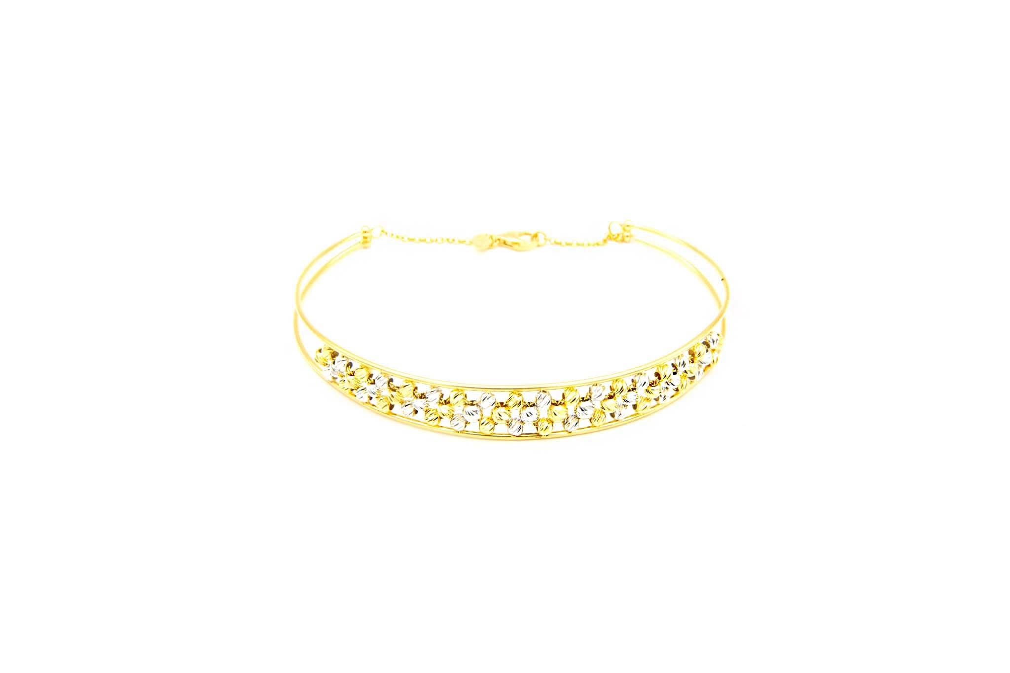 Armband opengewerkte band gevuld met diamond cut balletjes-1