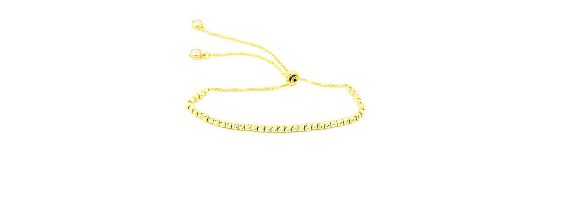 Armband met diamond cut balletjes en zirkonia's