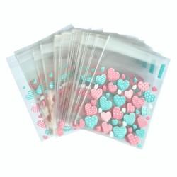 Fako Bijoux® - 100x Uitdeelzakjes - Cellofaan Plastic Traktatie Kado Zakjes - Snoepzakjes - Hartjes Roze/Groen - 7x7cm