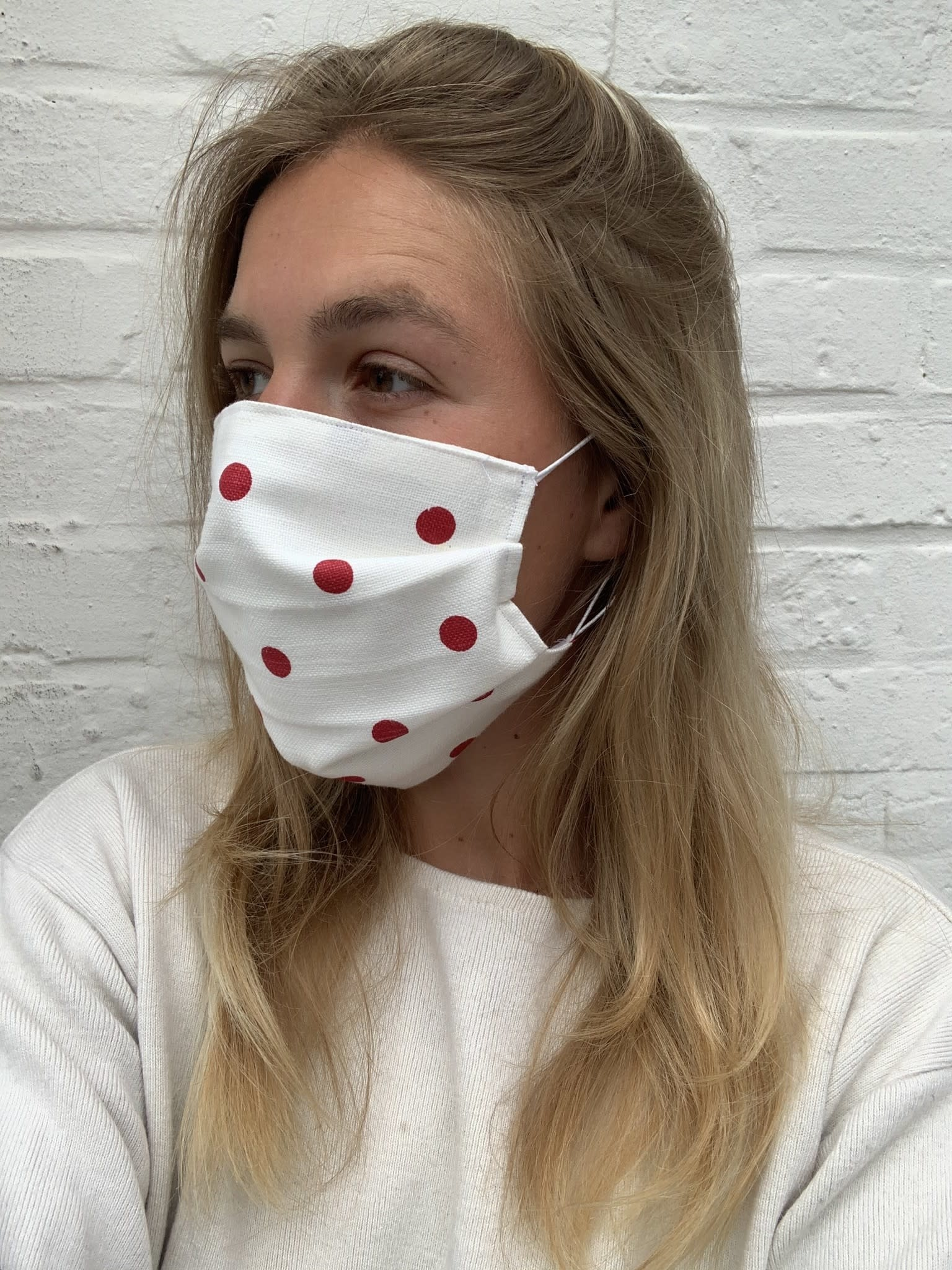 White mask with red dots