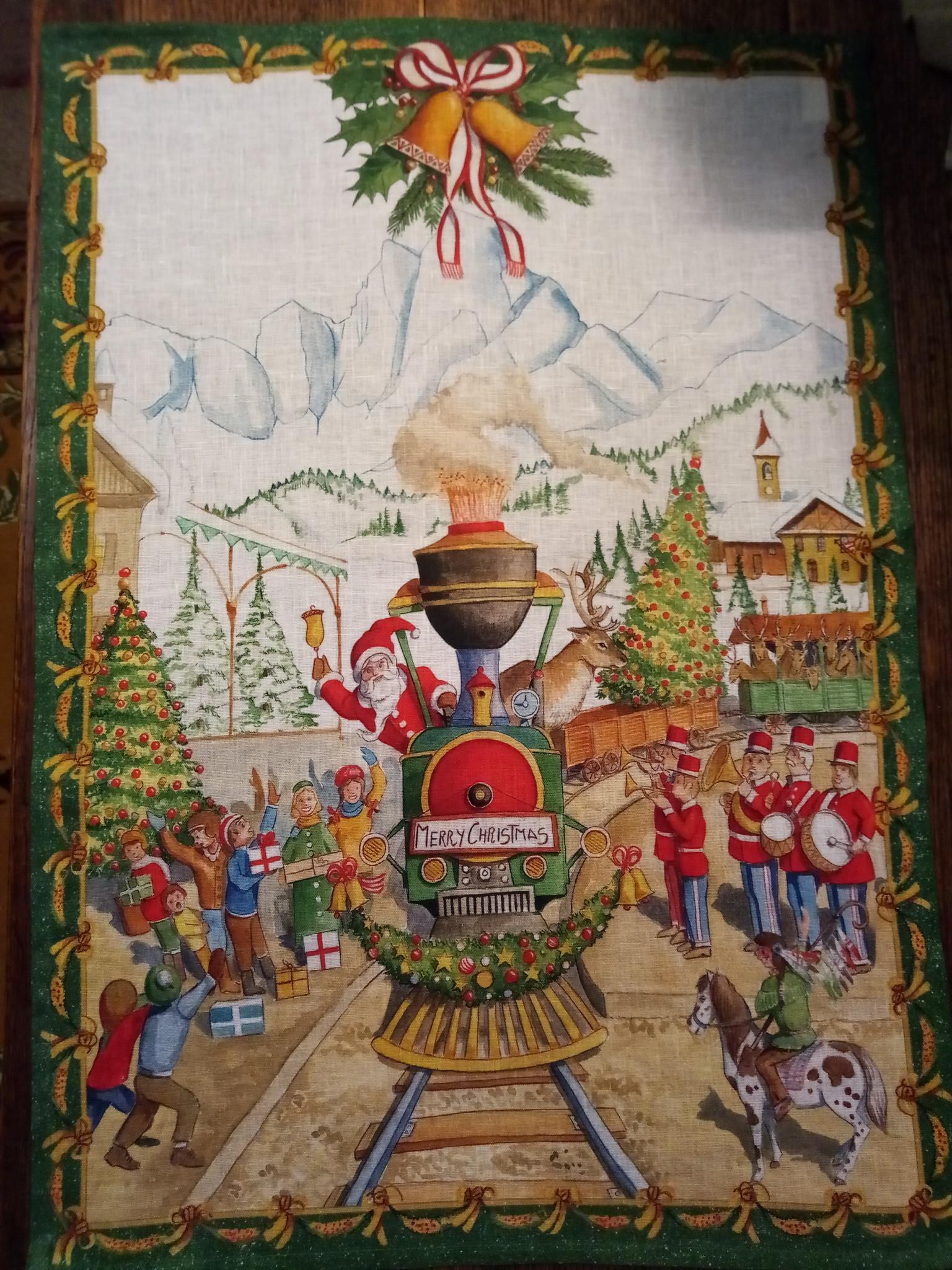 De kerstman met het treindoek.