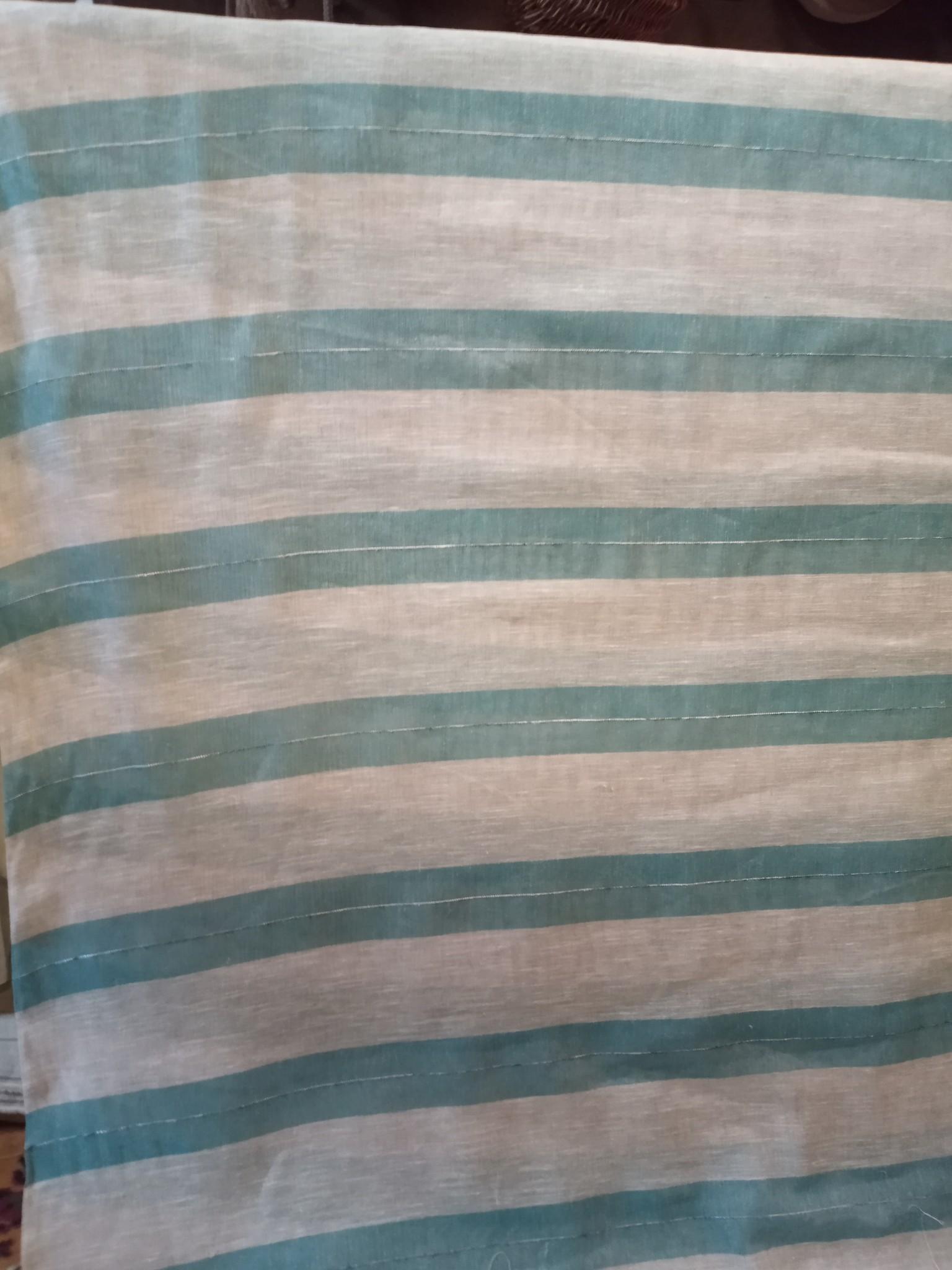 Ecru and blue striped curtain