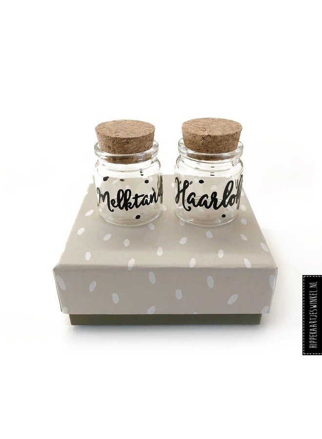 Haarlokje en melktandjes potjes in cadeauverpakking