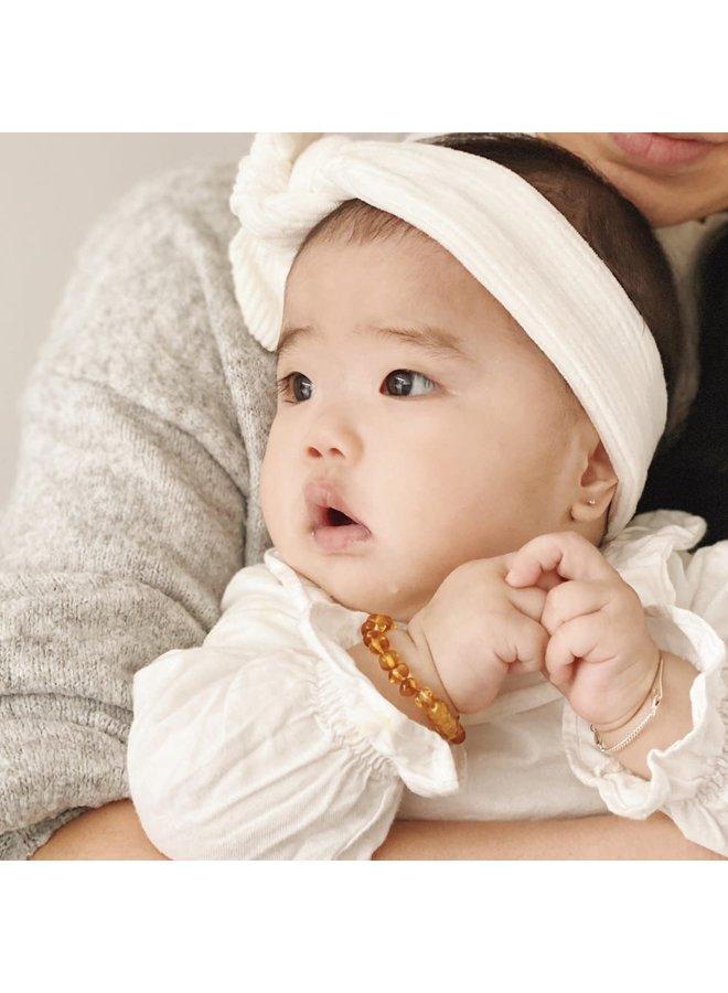 Amber baby armbandje