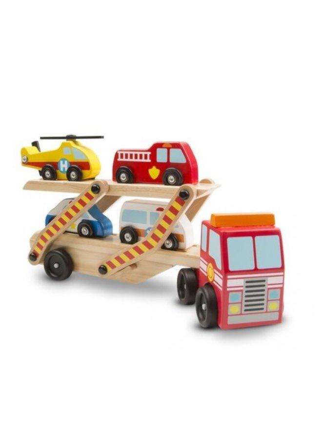 Vrachtwagen met noodvoertuigen