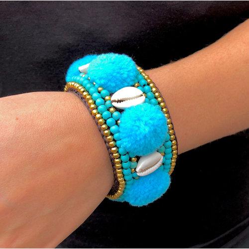 PomPom Cowrie klemarmband blauw