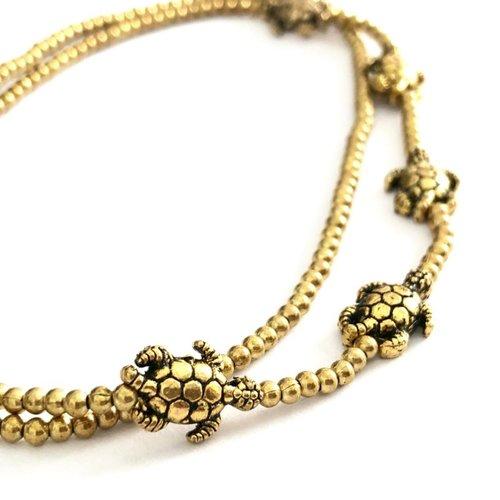 Enkelbandje schildpadjes goudkleurig