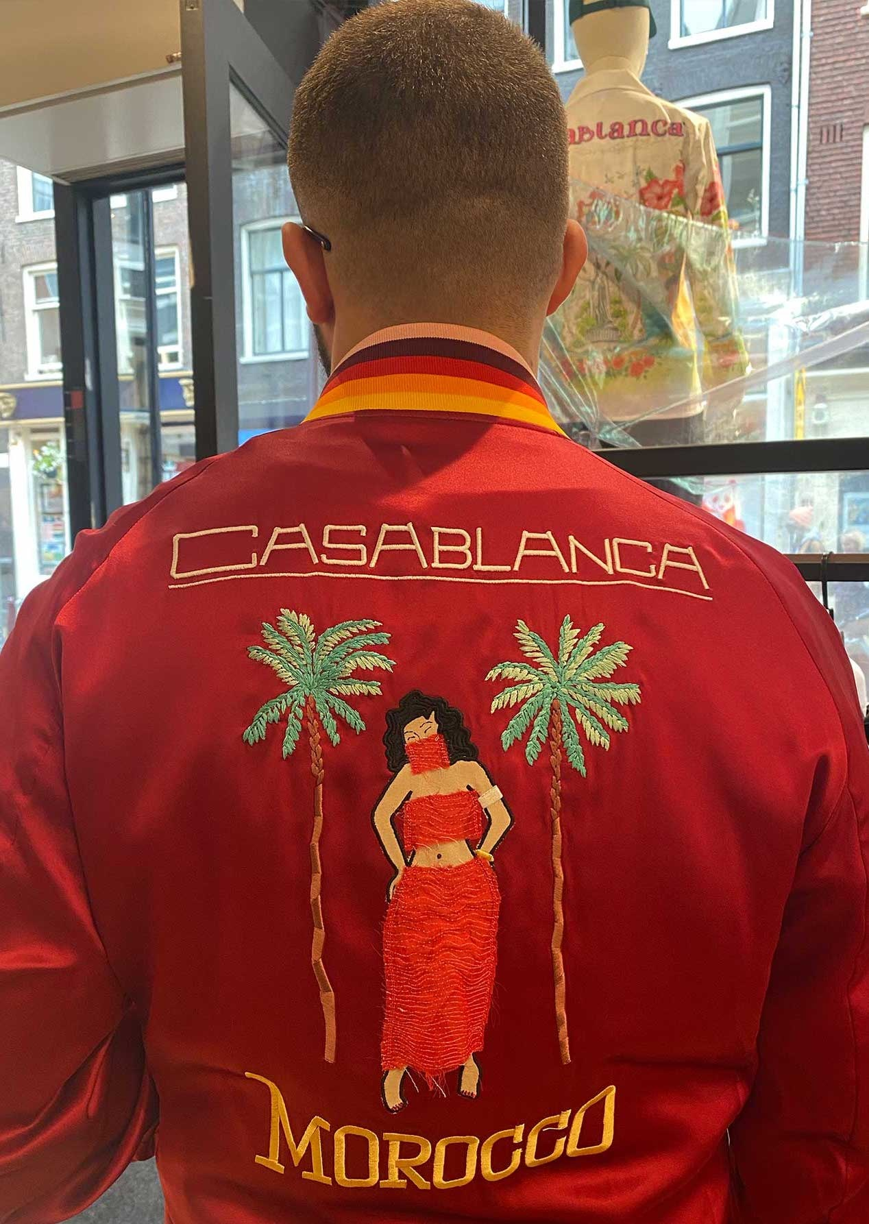 Sacha wears a red satin Casablanca Paris bomber with a Hawaii style embroidery