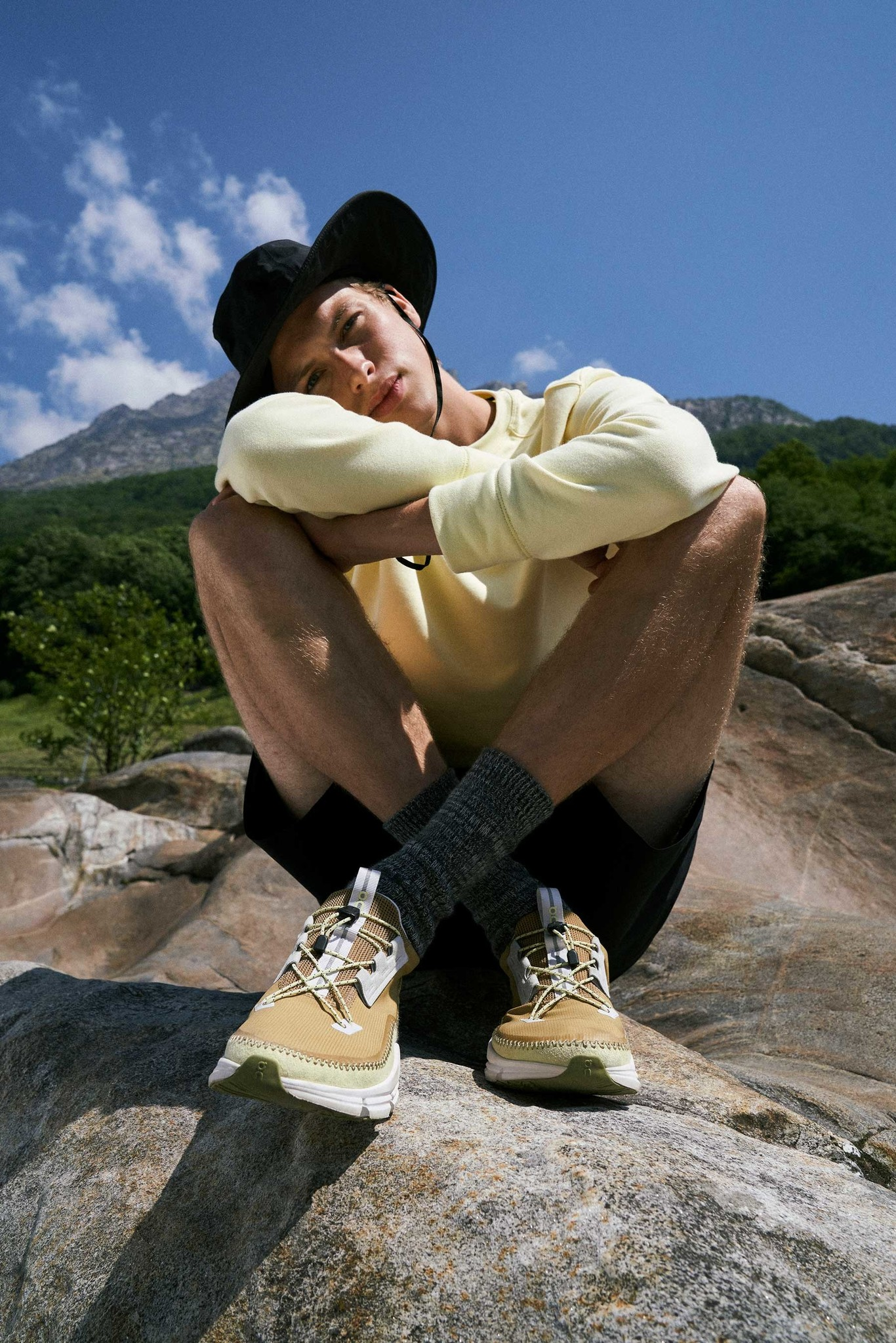 model poses on a rock