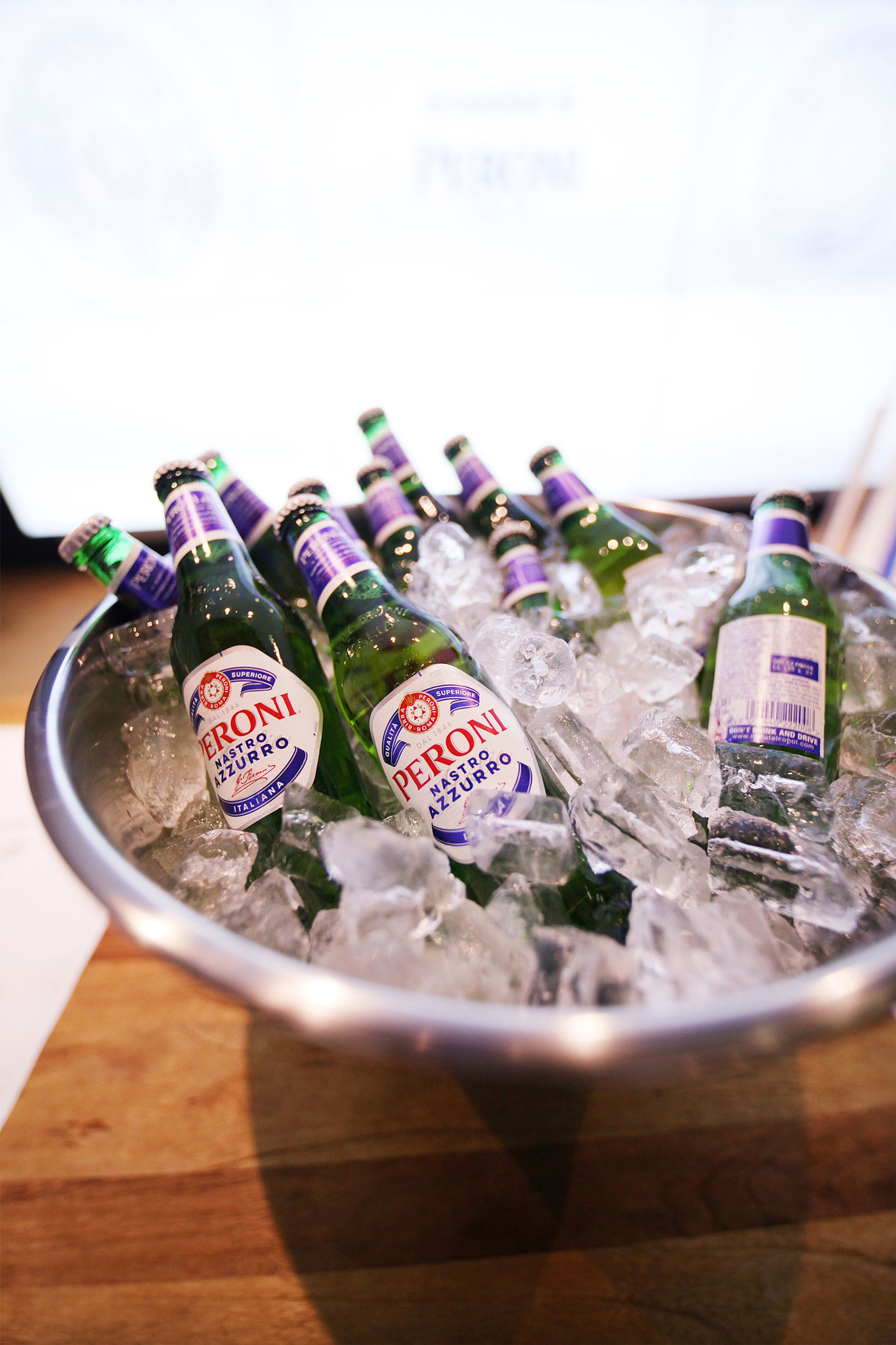 Ice bucket filled with Peroni beers
