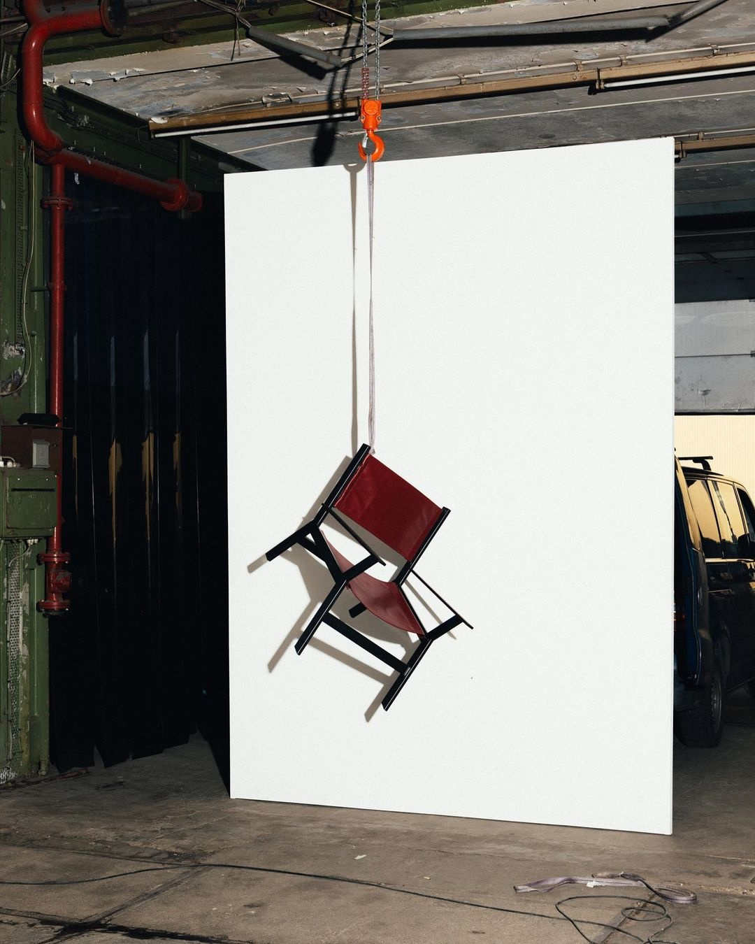 Designer chair hanging from ceiling