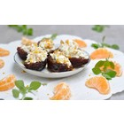 Stuffed dates with goat cheese, nuts and tangerines