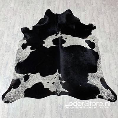 Zwart wit koeienhuid gevlekt