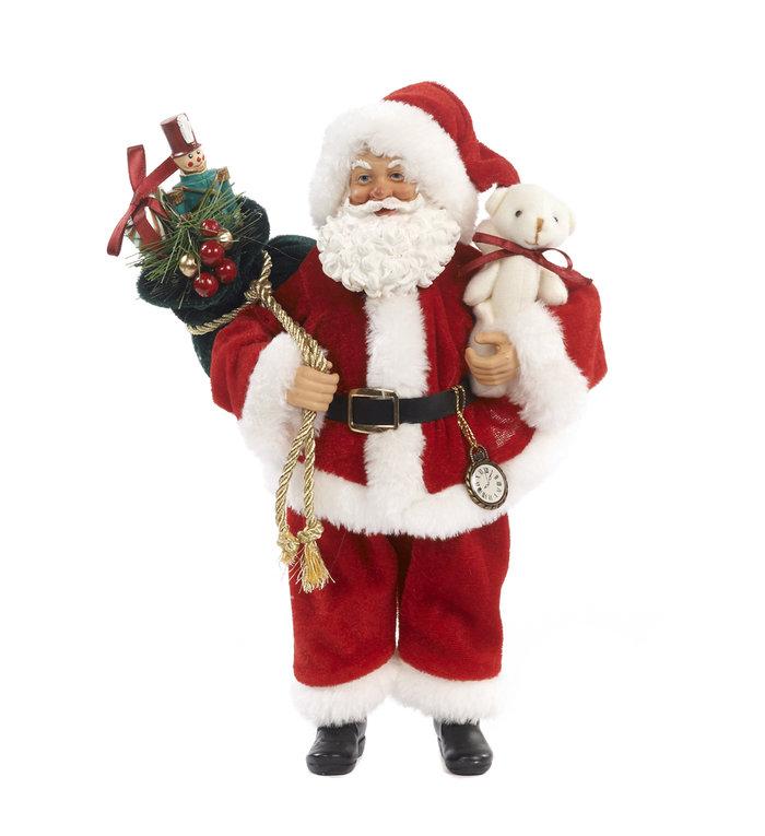 Kerstman figuur met cadeautas en beer 28 cm