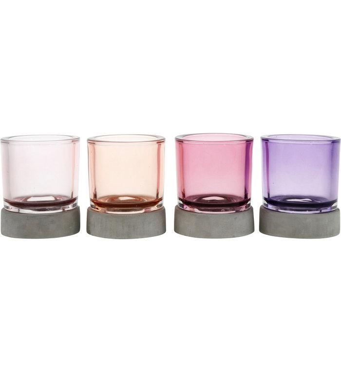Vier waxinelichthouders met roze en paars glas met grijze voet