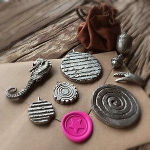 Tingieten, amulet of zegellakstempel