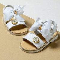 Leather sandals with bow and charm