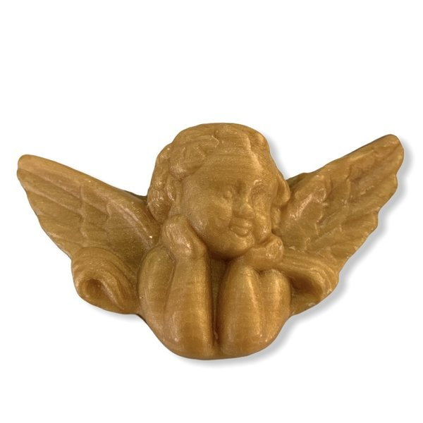 Soap in the shape of an angel gold colored