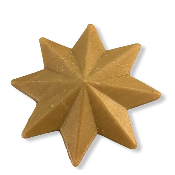 Soap in the shape of a star gold colored