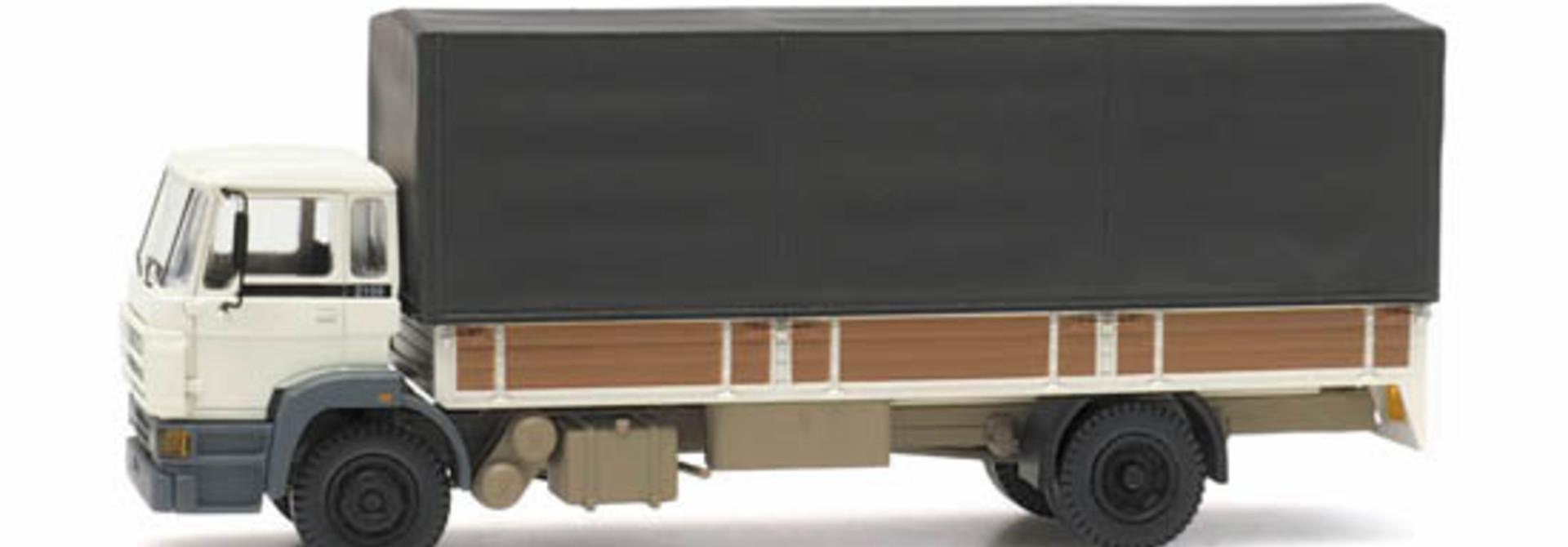 487.053.02 - DAF kantelcabine 1987, open bak, huif, wit