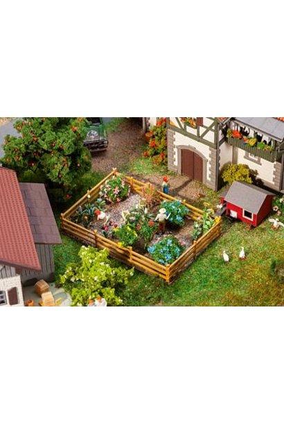 181276 Ziergarten mit Blumen und Büschen