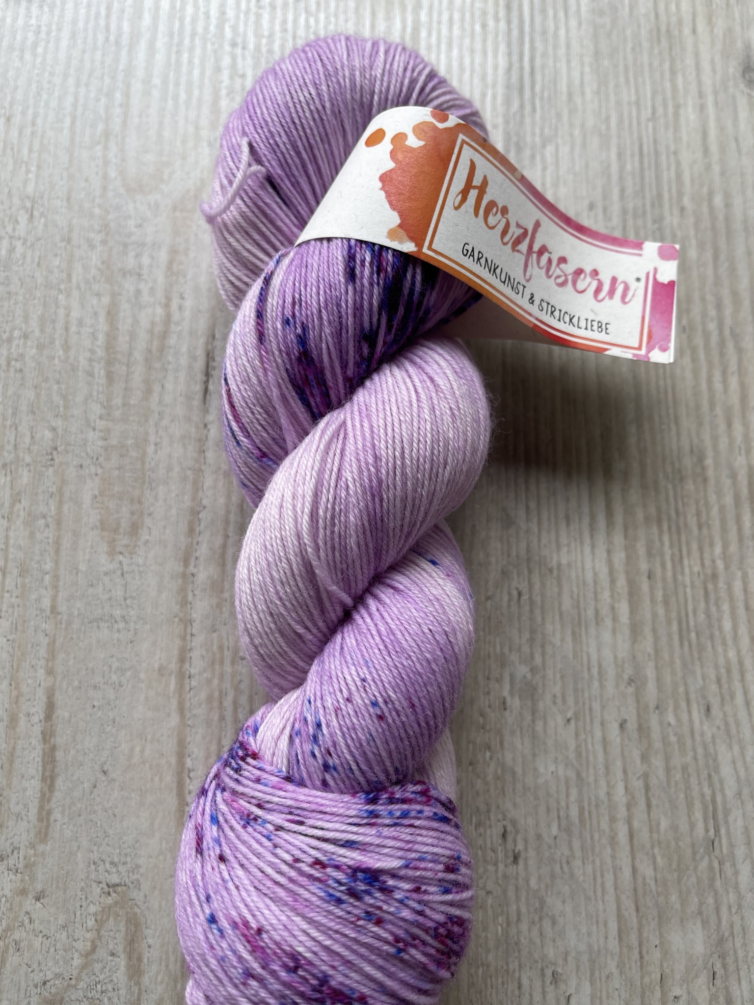 Sockenwolle -Lila light gesp.