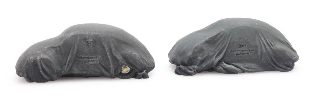 Chargo: Two VW Beetles under tarpaulin