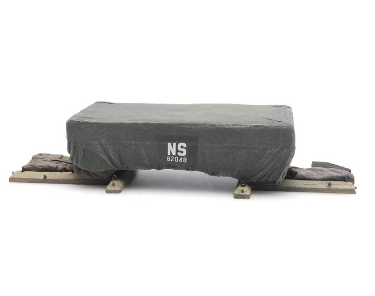 "Cargo: Shipping crate under tarpaulin ""NS"""