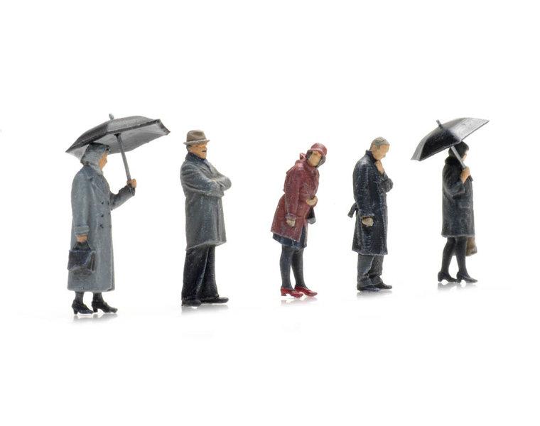 Passagiers in regen