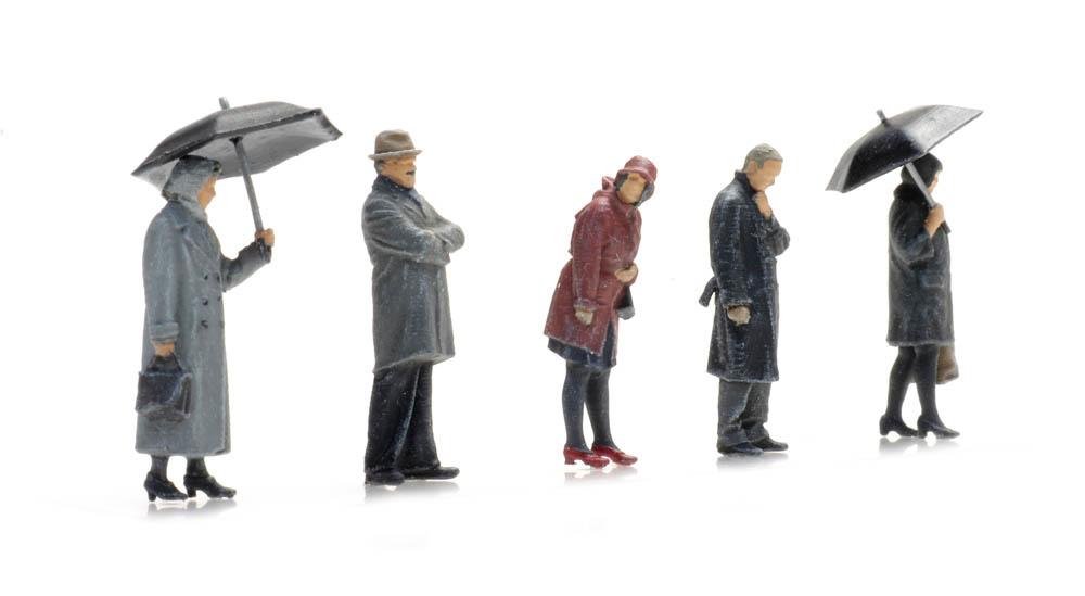 Passagiere im Regen