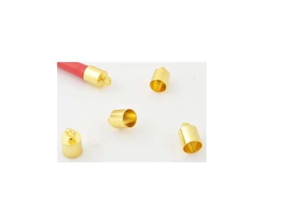 Metalen kapjes ± 11x7mm (gat ± 6,5mm en oogje ± 2mm) goud