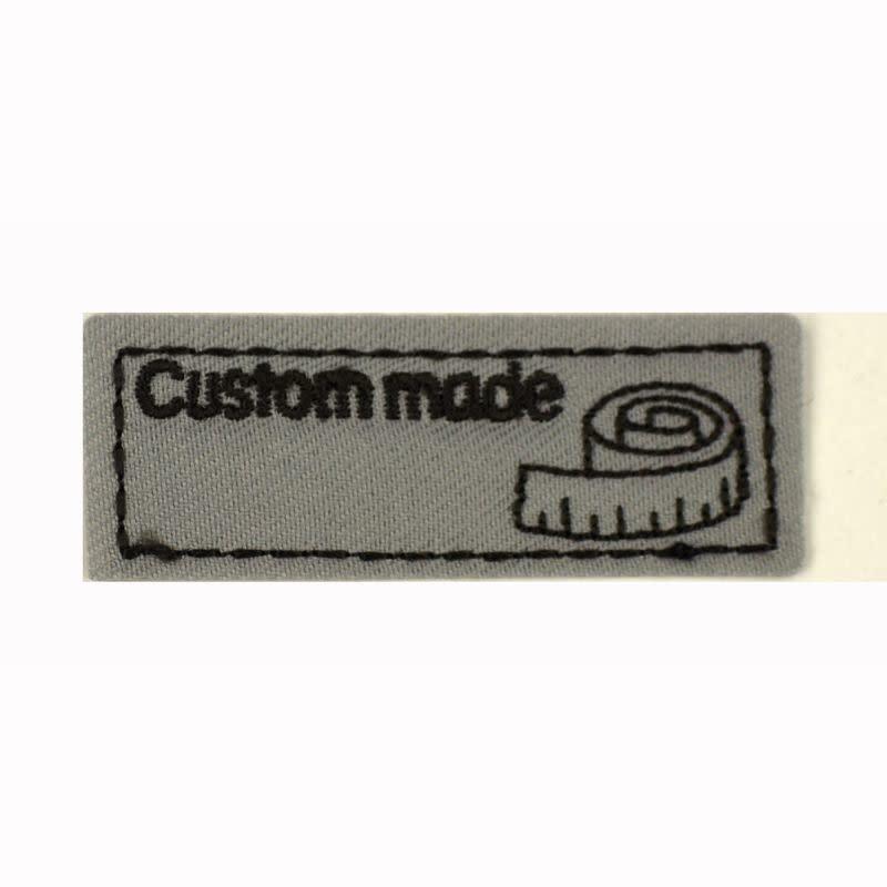 Applicatie Custom Made 55x20mm grijs