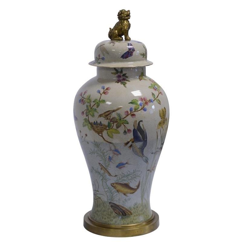 A BRASS MOUNTED PORCELAIN JAR