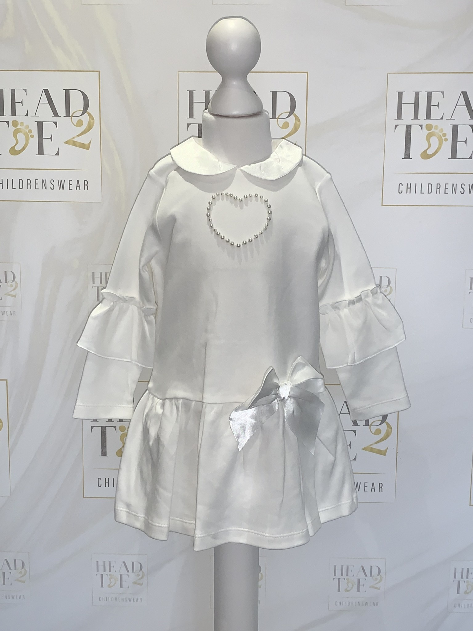Mintini Baby Mintini Girls off white pearl heart dress with bow detail 18 Months MB2812A
