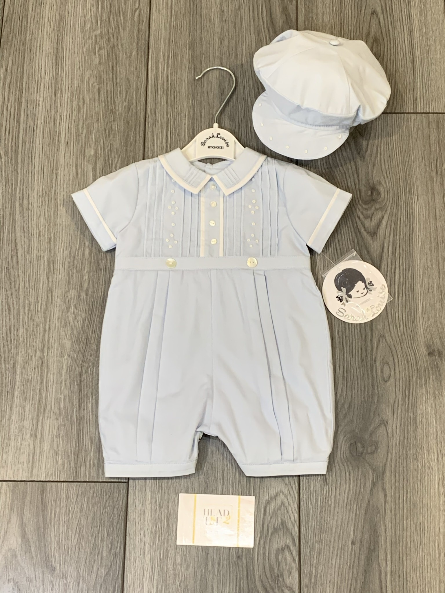 Sarah Louise Sarah Louise SS20 Boys Blue Romper And Cap with White Detail 011792